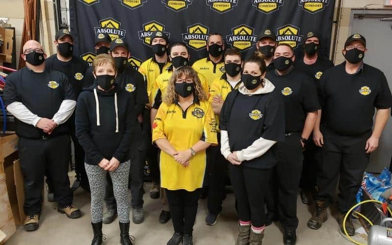 absolute comfort team with masks on